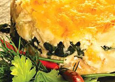 Bacalhau gratinado em cama de espinafres